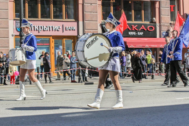 Girls with big and small drums. Day festive demonstration on the Nevsky Prospect in St. Petersburg, the first of May royalty free stock photos