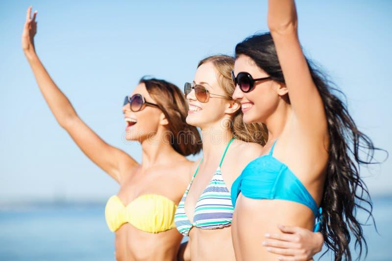 Download Girls In Bikini Walking On The Beach Stock Photo - Image: 33338192