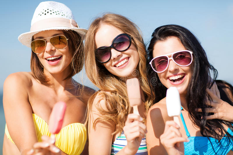 Download Girls In Bikinis With Ice Cream On The Beach Stock Image - Image of shades, snack: 33507779
