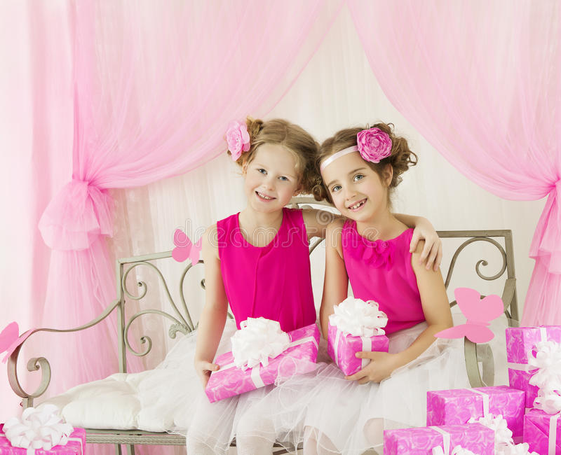 Girls Birthday, Kids Retro Pink Dress with Present Gift Box stock photo