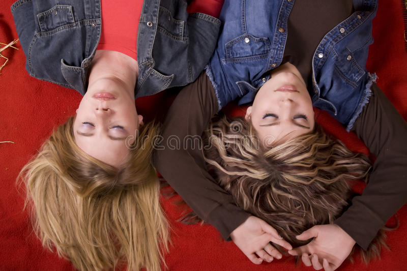 Girls On Blanket Eyes Closed Top View Stock Photo