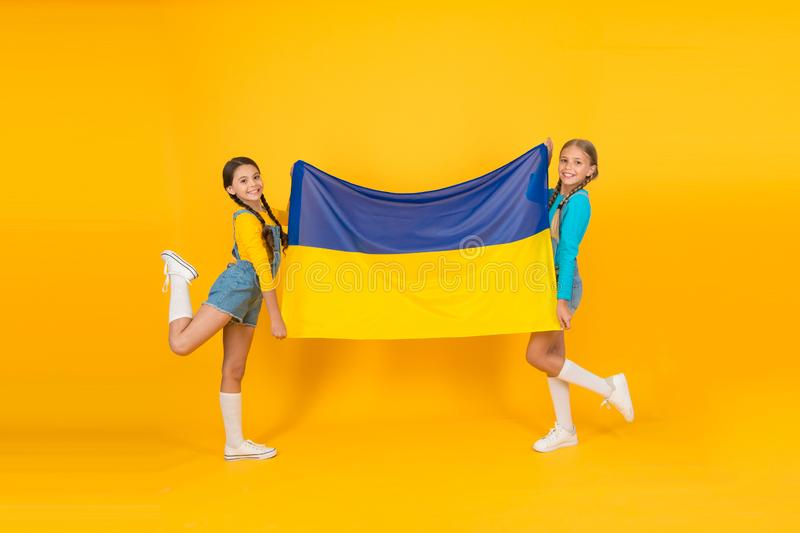 Girls with blue and yellow flag. Patriotic education. Happy independence day. Children hold ukrainian flag. Ukrainian. Kids. Celebrate national holiday royalty free stock photos