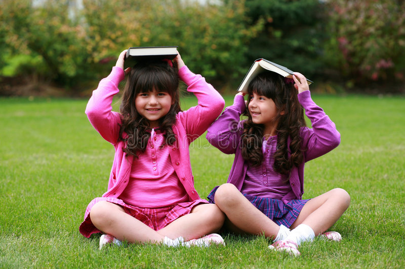 Download Girls with books on head stock image. Image of faces, female - 7254993