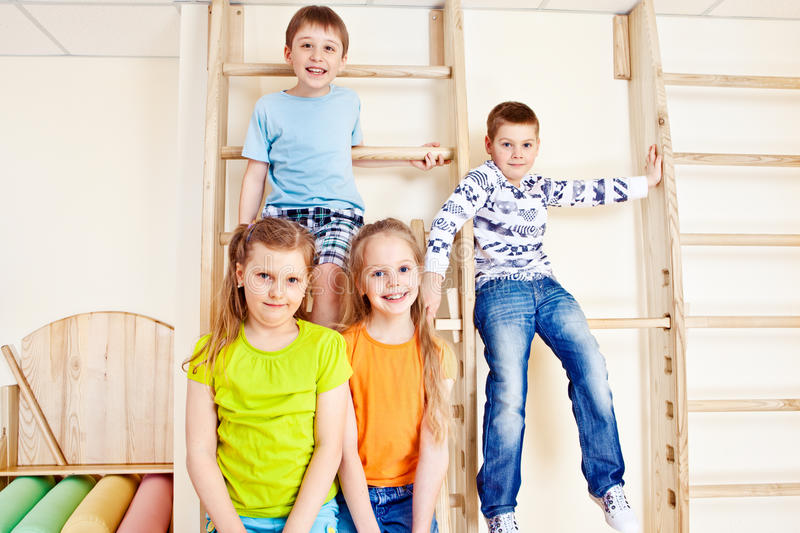 Girls and boys in gym royalty free stock photo