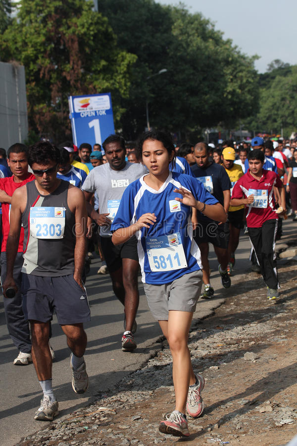 Girls and Boys participate in bangalore marathon. Bangalore, India - May 27: Professional athletes and other participants participate in Tata Consultancy royalty free stock photos