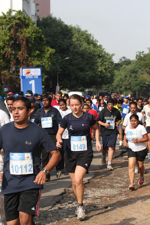 Girls and Boys participate in bangalore marathon. Bangalore, India - May 27: Professional athletes and other participants participate in Tata Consultancy royalty free stock photo
