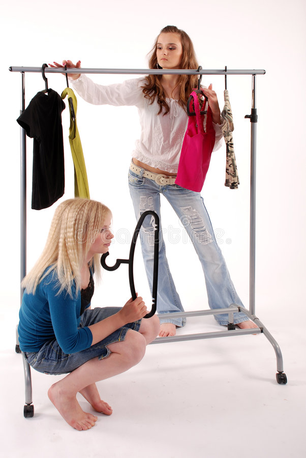 Girls are buying clothes stock image