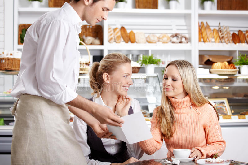 Girls in cafe royalty free stock photo