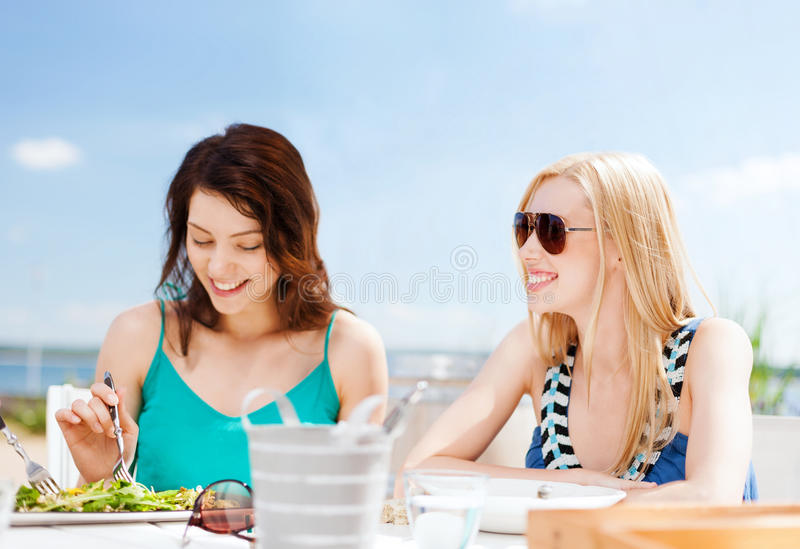 Download Girls in cafe on the beach stock image. Image of beach - 33665785