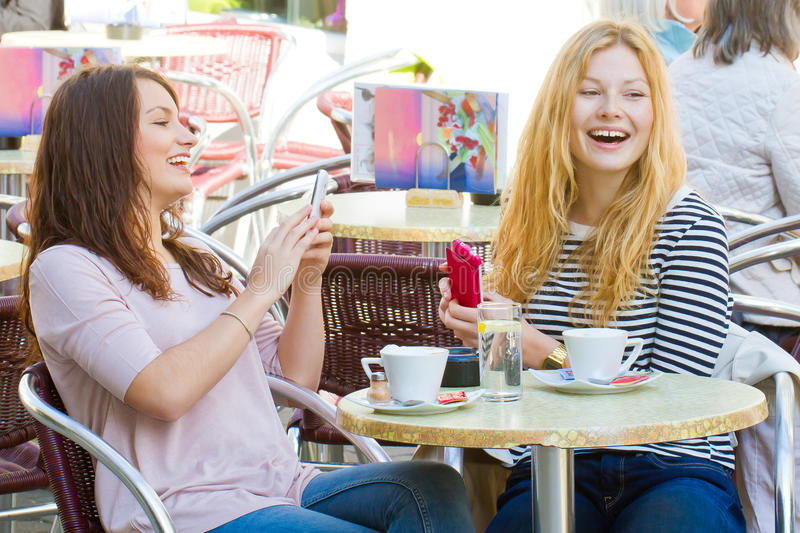 Girls in a cafe having fun royalty free stock images
