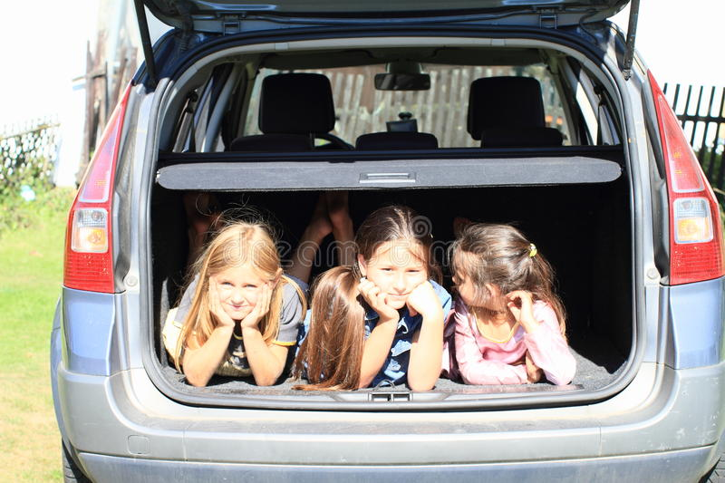Girls In Car Trunk Royalty Free Stock Images