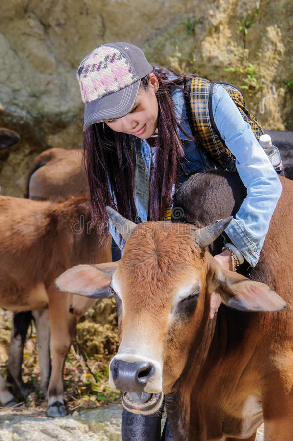 Girls and cattle stock images