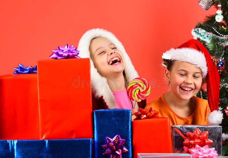Girls celebrate New Year, have fun. Kids in Santa hats stock photography