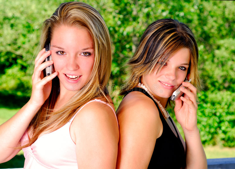 Girls And Cellphones royalty free stock photos
