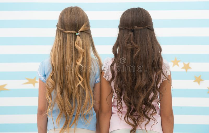 Girls children long curly hair rear view. Treat hair proper way according type. Apply conditioner mask after washing and royalty free stock image