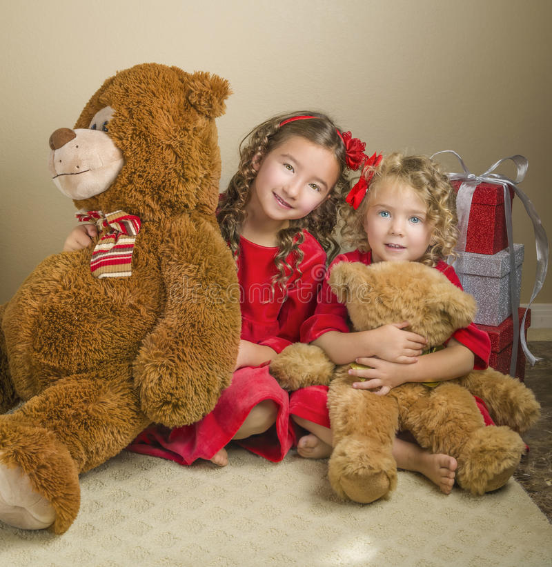 Girls With Christmas and Bears Presents royalty free stock images