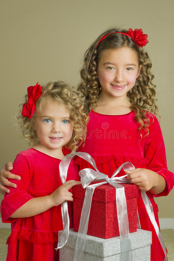 Download Girls With Christmas Holiday Presents Stock Photo - Image of dresses, children: 34305188