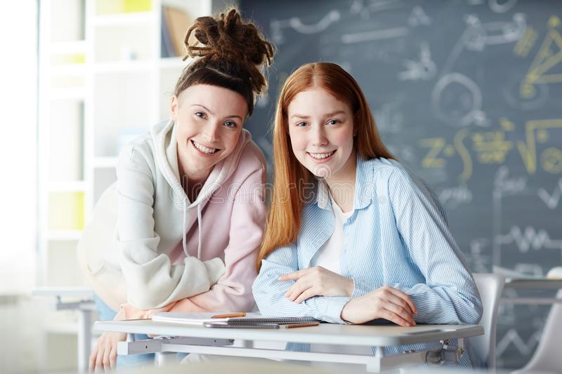 Girls in classroom stock image