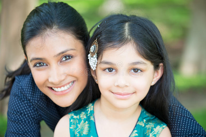 Girls. Closeup portrait, family looking at camera, outdoors outside background stock image