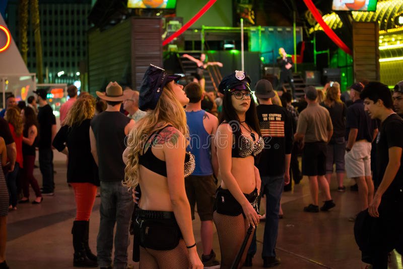 Girls cop. Las Vegas, Freemont street ,cop girls win money stock photos