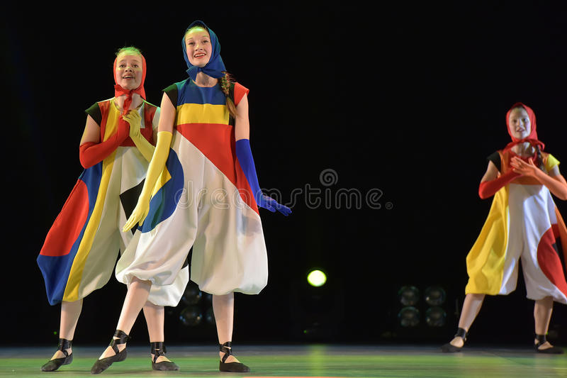 Girls in costume dolls dancing on stage. Dance performance on stage, Festival of children`s dance groups, St. Petersburg, Russia stock photos