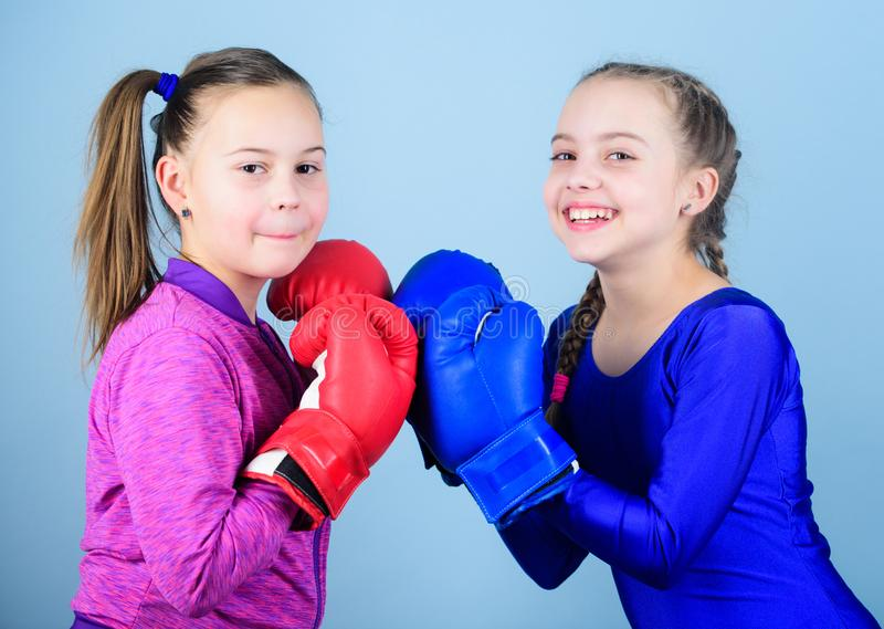 Girls cute boxers on blue background. Friendship as battle and competition. Pass boxing challenge. Test for fortitude. Female friendship. Girls in boxing sport royalty free stock image