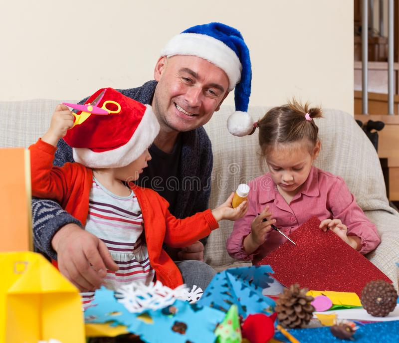 Girls with Dad doing crafts. stock photo
