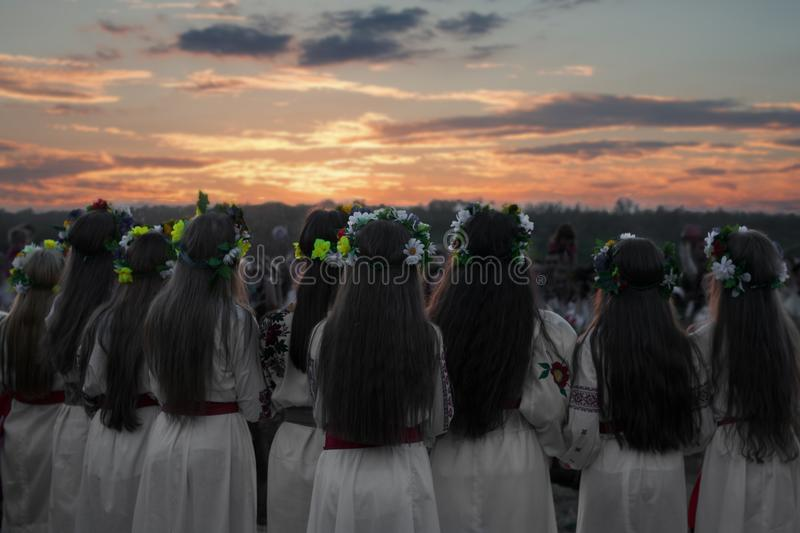 Girls in a dance, people`s rite, wreaths on their heads, a holiday of Ivan Kupala royalty free stock photography