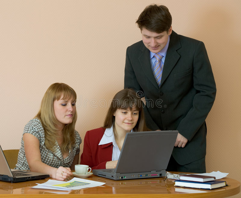 Download Girls At A Desktop And Their Chief Stock Image - Image: 8696243