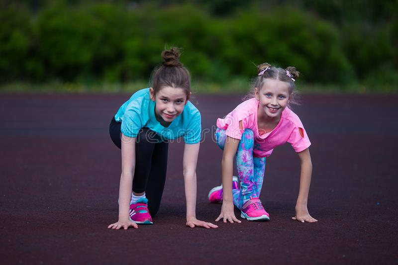 Girls are doing exercise in the stadium. Girls doing fitness at the stadium royalty free stock photography
