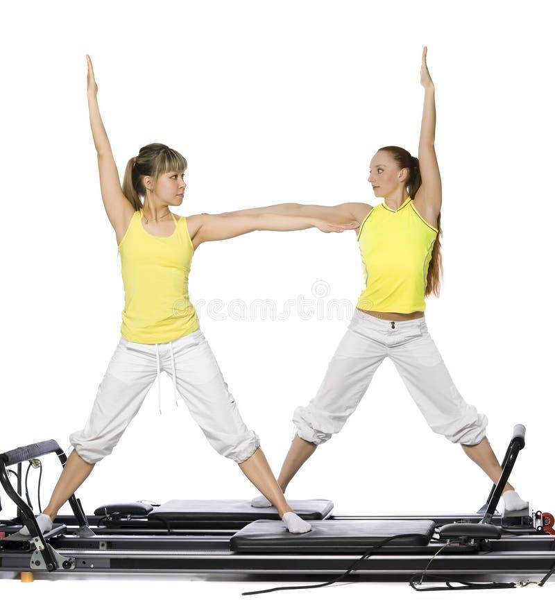 Girls are doing pilates stock image