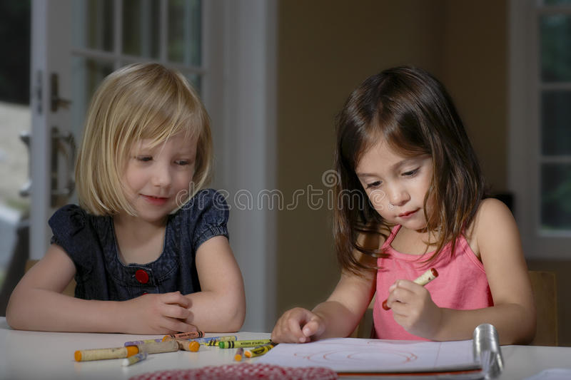 Girls Drawing With Crayons royalty free stock photography