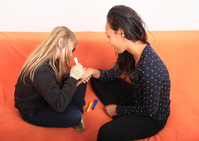 Girls drawing on hand stock image