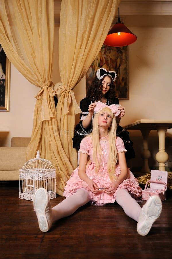 Girls dressed as dolls. stock image