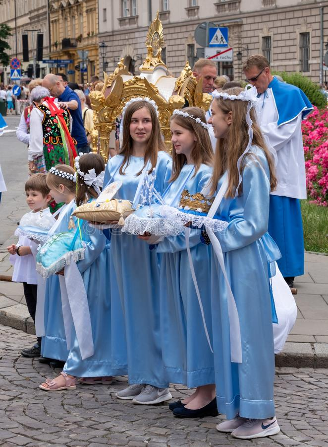 Girls dressed in blue traditional costumes at a procession for the Feast of Corpus Christi in Krakow, Poland royalty free stock photography