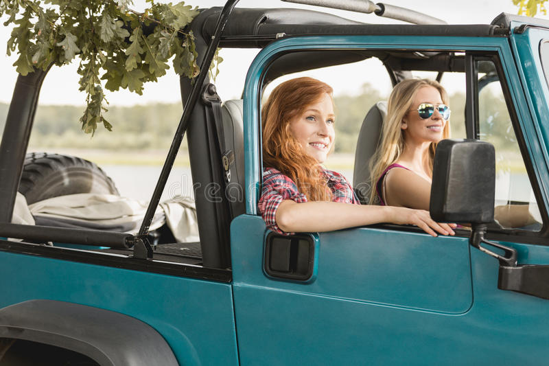 Girls driving car royalty free stock photo