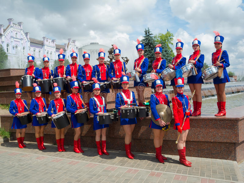 Girls drummers posing. SUMY - JUNE 28: Girls drummers posing for a group photo at celebration of the Day of Constitution of Ukraine on June 28, 2012 in Sumy stock photos