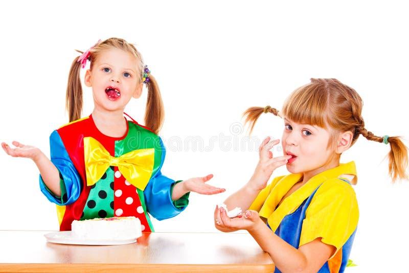 Girls eating cake royalty free stock images