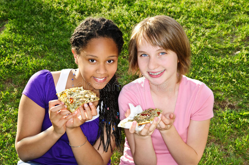 Download Girls eating pizza stock image. Image of holding, health - 10467209