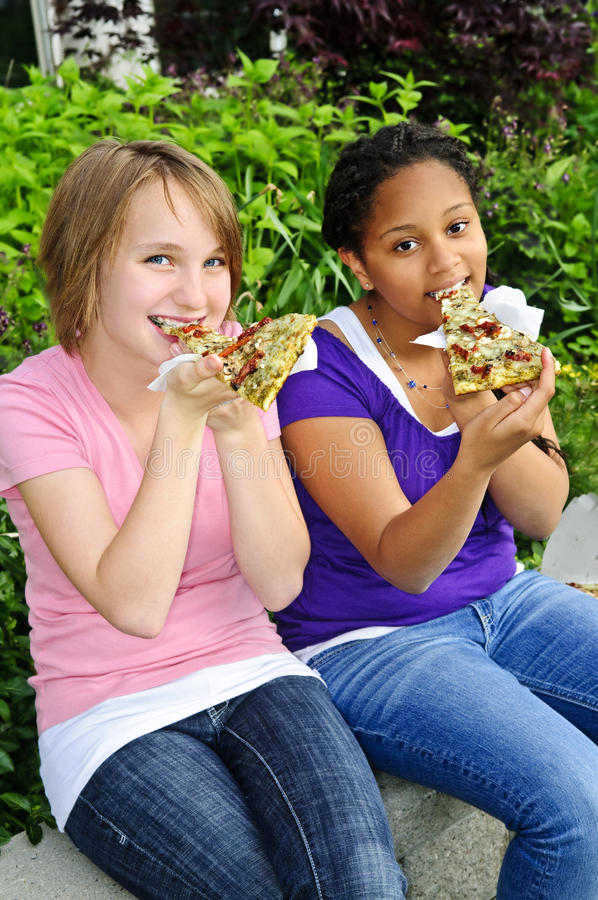 Download Girls eating pizza stock photo. Image of pizza, happy - 10525636