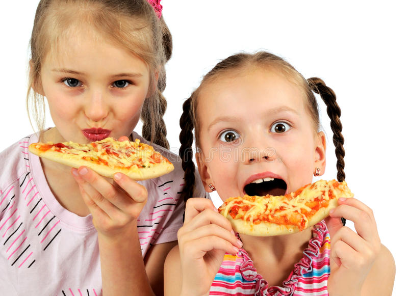 Girls eating pizza stock image