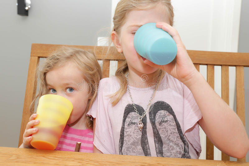 Girls eating royalty free stock photos
