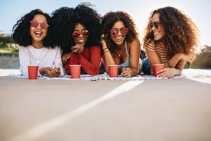 Girls enjoying weekend on beach royalty free stock image