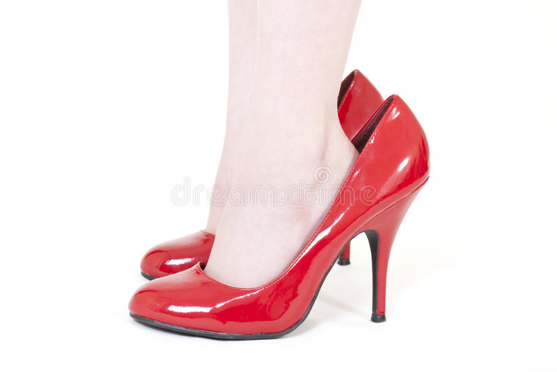 Girls Feet In Mum S Shoes Stock Photography