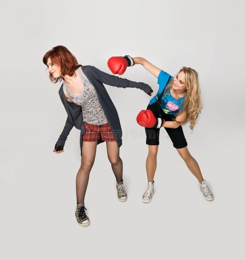 Girls fighting stock photos