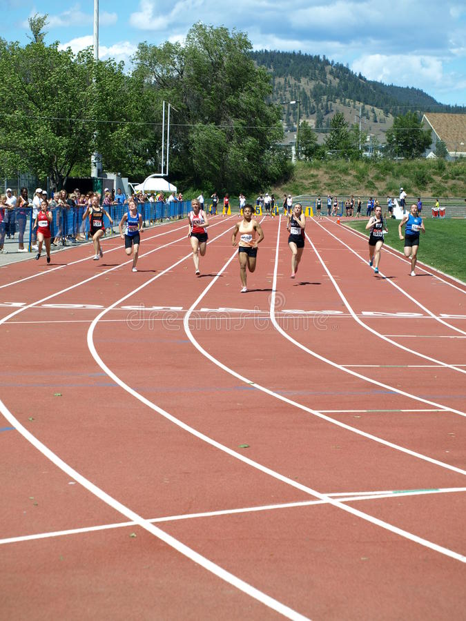 Girls on finish 100 meters dash. KELOWNA, CANADA - Clarke Shania, Griffin Robyn, Gilbert Tyra, Carrothers Katie, Wilkes Maya,Dietrich,Geary Caitlin,Frenkel Carly royalty free stock photo