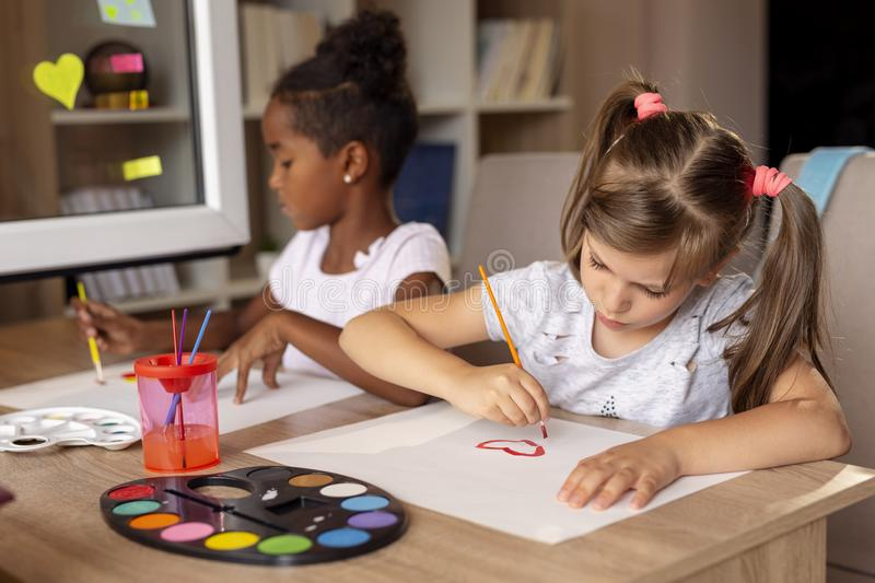 Girls finishing their arts project stock images