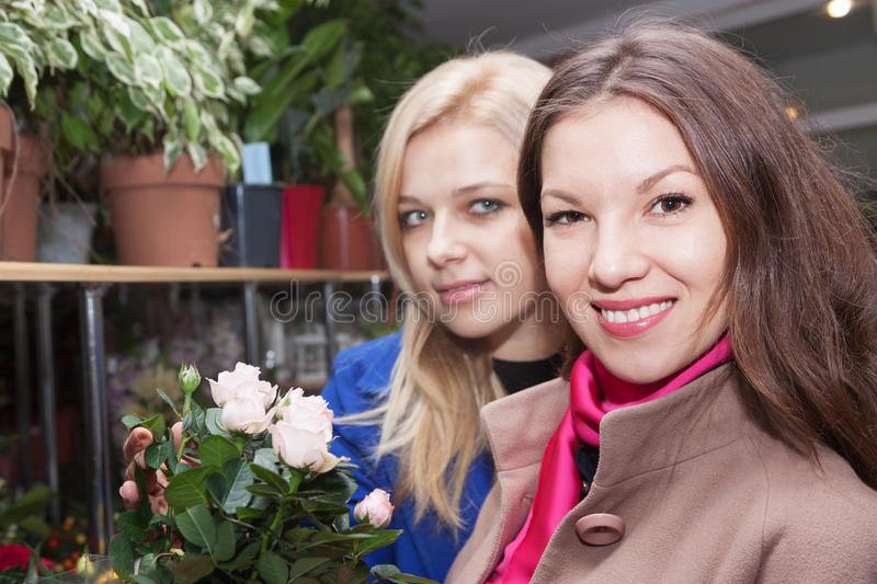 Girls in a flower shop stock photography