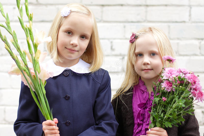 Girls With Flowers - First Day Of School Royalty Free Stock Images
