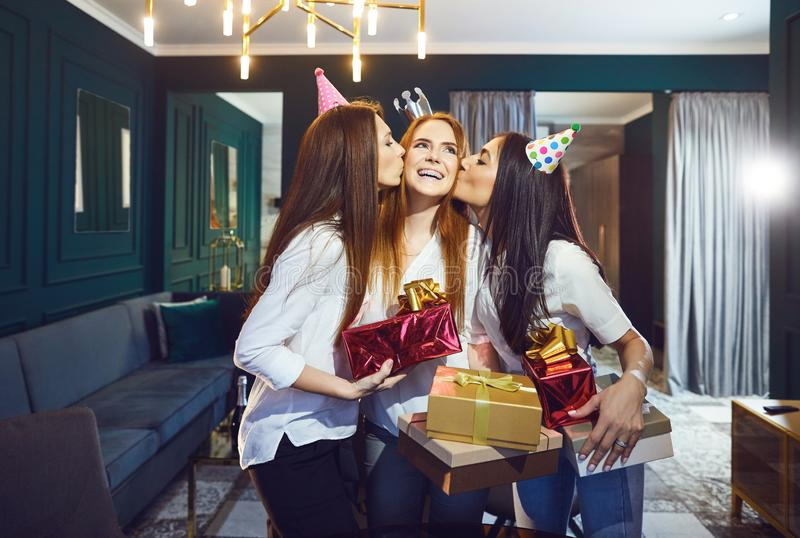 Girls friend congratulate gifts for a birthday party stock image